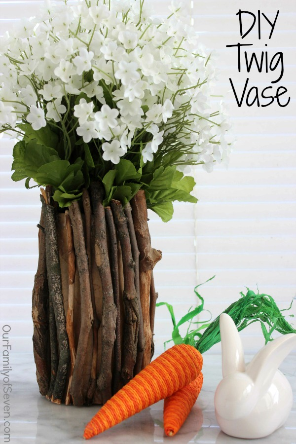 This DIY Twig Vase is SUPER Easy and SUPER Inexpensive- It will make for a perfect accessory for your spring or all year long decor.
