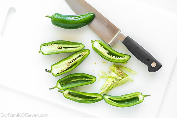 Slicing jalapeno peppers
